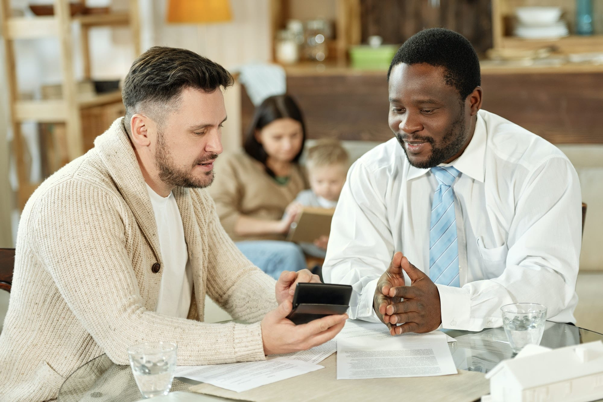 Ethnic man consulting client on home loan